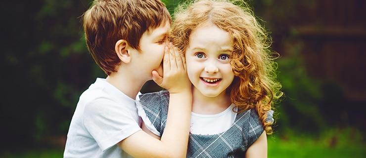 Children sharing a secret.