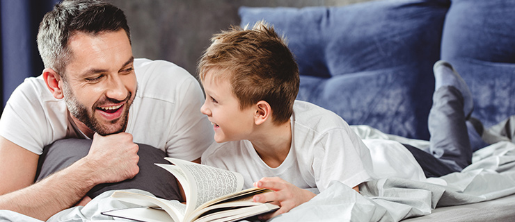 Father and son reading together.